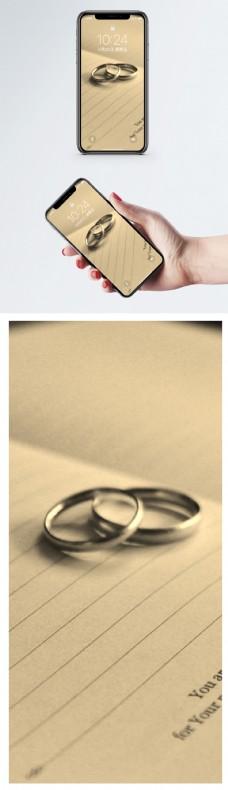 日记本里的对戒手机壁纸